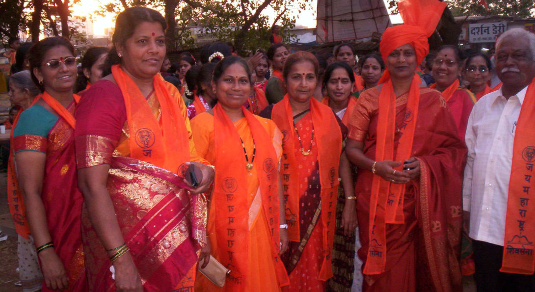 Brightly Dressed women and men in Mumbai at a Rally